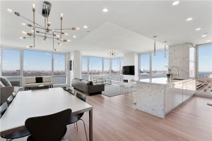 the-apartment-is-wide-open-with-white-oak-flooring-granite-countertops-and-sub-zero-appliances (1)